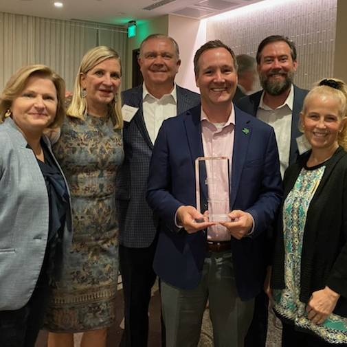 Dan Tenney named CFO of the Year for Higher Education, posed with his wife Crystal, Chancellor Lesa Roe (left), Board Chair Laura Wright and husband Randy Wright and Chief Communications Officer Paul Corliss
