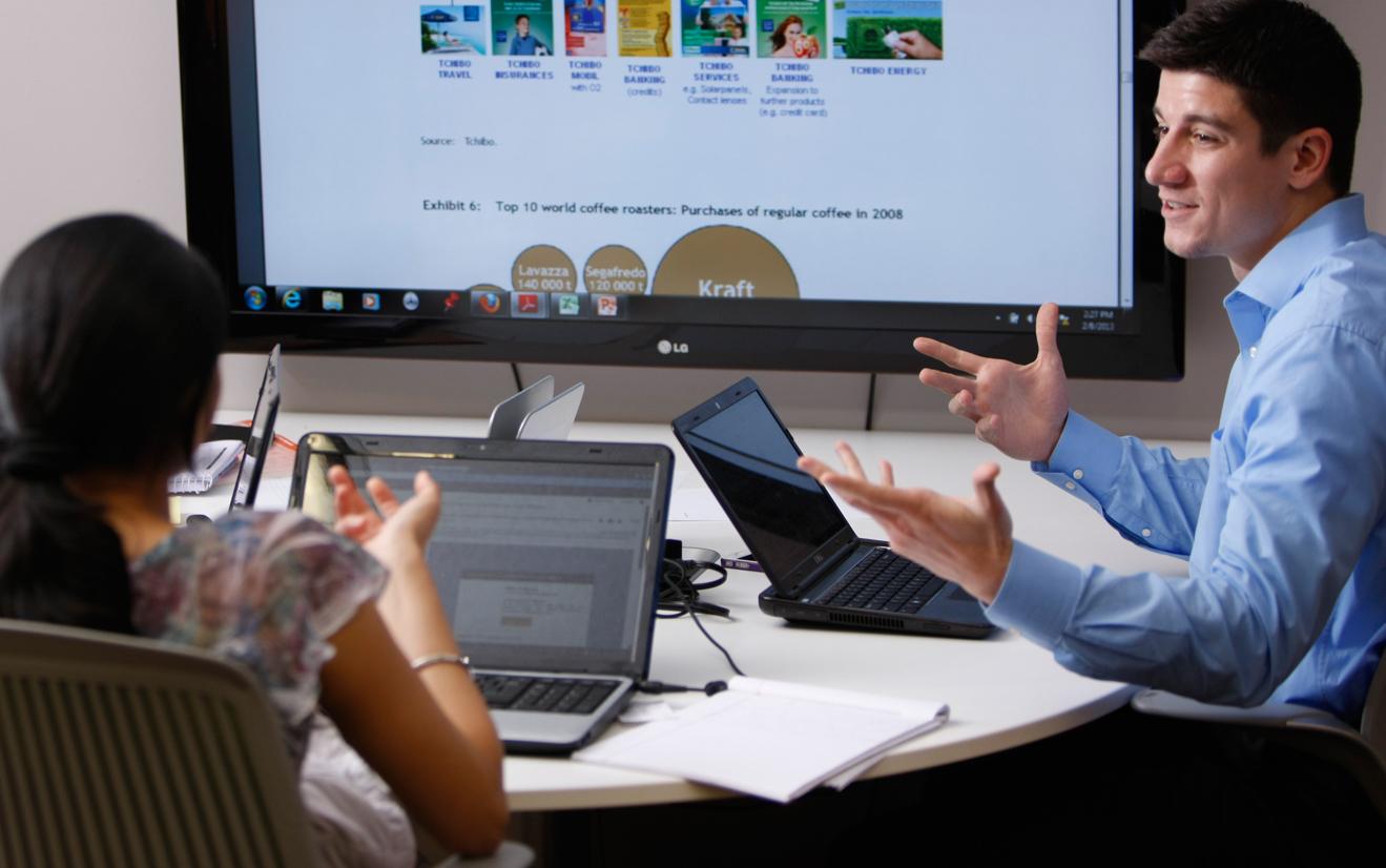 UNT Students using laptop in a class